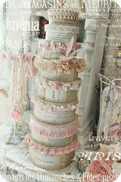 This can be done with bottles and jars, too. I have the papers and lace. Now I must find the time.