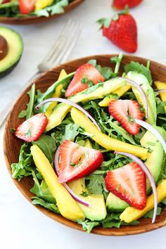 Mango, Strawberry, and Avocado Arugula Salad Recipe on twopeasandtheirpod.com. This gorgeous salad is simple to make and perfect for summer! #salad #glutenfree #vegan