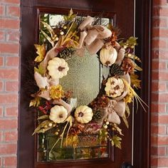 We think the cream accent of the pumpkins in this wreath is great looking! #kirklands #harvest