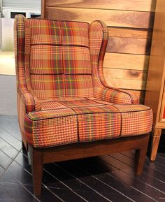 Fabulous plaid with piping!  From apartment therapy's Favorite Chairs at ArchDigest Home Show    New Traditionalists — Hello, plaid! The company's Chair No. One Eighty in plaid upholstery with leather piping detail.