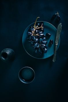 Dark blue tableware and linen make for a dramatic, gothic tablescape. WGSN-homebuildlife subscribers can read more on dark interiors...