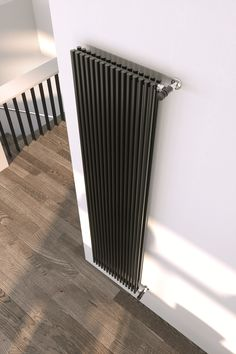 How to replace your old heater Upright Radiators, Old Radiators, Vertical Radiators, Wall Heater Cover, Vinyl Garage Flooring, Decorative Radiators, Stainless Steel Radiators, Radiator Heater, Travertine