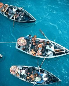 BUM BOATS OF HAITI - Port-au-Prince, selling wooden carvings to guests of cruise ships, by Bulent Atalay