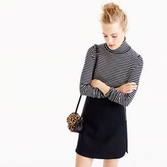 Our customer-favorite sweater since 2011, now in a cozy turtleneck silhouette. What hasn't changed: the fact that it's soft, flattering and still layers well—so don't be surprised if you wear it with almost everything. <ul><li>Semifitted.</li><li>Hits at hip.</li><li>Merino wool.</li><li>Long sleeves.</li><li>Rib trim at neck, cuffs and hem.</li><li>Dry clean.</li><li>Import.</li></ul>