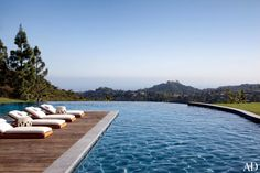 The pool area boasts views of the city with the Pacific Ocean in the distance | archdigest.com