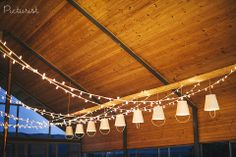 How cool are these bucket lampshades?! From Caz & Fish's wedding at Old Mac Daddy's.