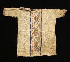 A COPTIC TEXTILE TUNIC FOR A CHILD CENTURY A. The central panel with red, yellow and green embroidered foliate motifs bordered by two white and dark blue bands, the collar and sleeves edged with red and white bands 15 in. Medieval Clothing, Historical Clothing, Roman Clothes, Egyptian Fashion, Medieval Tapestry, Ottoman, Early Christian, Weaving Textiles, Period Outfit