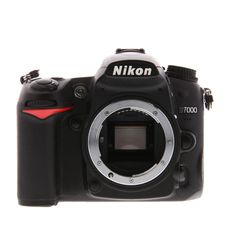 Though now discontin Though now discontinued the Nikon is still a favorite among photographers. The semi-professional body comes equipped with great features including two sd card slots dynamic iso range and a great auto focus system. Vlogging Equipment, Camera Equipment, Nikon Camera Lenses, Camera Gear, Nikon Cameras, Nikon D7000, Photoshop Elements, Travel Humor, Camera Settings