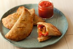 """(link) PIZZA HAND PIES ~ Bite sized pepperoni pizza hand pies stuffed with cubes of mozzarella, spicy pepperoni and a dollop of pizza sauce! ~~~ HINT; Feel free to change it up! Use different """"toppings"""" to stuff your pizza hand pies: Italian Sausage, Ham, mushrooms, onions and / or green bell peppers. Should have these items cooked / sauteed to ensure cooked properly & improve flavors prior to stuffing crust. DO NOT OVER STUFF, as that will make it difficult to seal the crust."""