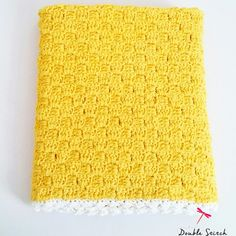 A lovely and soft vintage yellow baby blanket. It would make a wonderful babyshower gift.