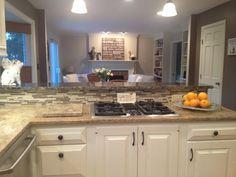 white kitchen w/ granite/mixed backsplash