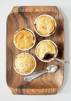 Looking for a less traditional — that is, compared to corned beef and cabbage — way to celebrate St. Patrick's Day this year? These hearty but daintily portioned Guinness-braised beef stew pot pies are just the ticket. Paired with an Irish brew or whiskey (or both) and a side of roasted vegetables, these pies make for an appropriately celebratory meal perfect for a casual dinner party.