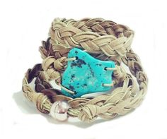 Turquoise and leather wrist wrap.