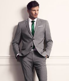 H US:A very classic and timeless grey suit with the Modern detail of a colored tie