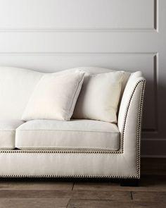 "<ul> <li>Sofa made of select hardwoods with polyester/linen upholstery.</li> <li>Studded trim.</li> <li>Scalloped back.</li> <li>Includes six matching accent pillows covered in polyester/linen and rayon/linen blend fabric.</li> <li>110""W x 41""D x 35.75""T.</li> <li>Made in the USA.</li> </ul>"