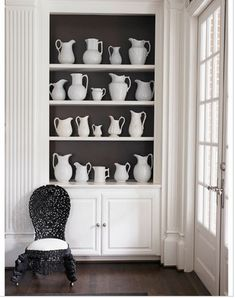 I'm thinking about this black back for my built-ins. I am in the process of taping black construction paper up to see if I like it. Note to self.
