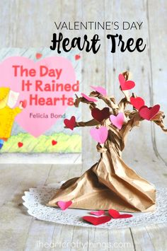 Pretty Valentine Heart Tree Craft that goes along with the book The Day it Rained Hearts. Fun Valentine's Day Craft for kids, preschool book craft and book inspired children's craft.