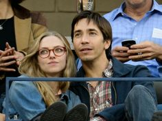 Amanda & Justin: New-Found Romance  Love is in the air! New couple Amanda Seyfried and Justin Long keep each other close as they watch the U.S. Open in N.Y.C on Sept. 9.