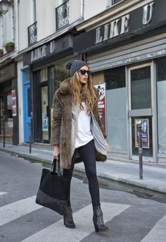 Love these layers: casual shirts with a luxe fur coat.