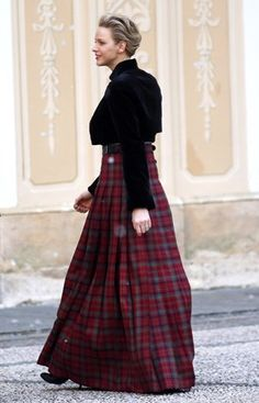 Getting into the Christmas spirit in this floor-length tartan skirt.