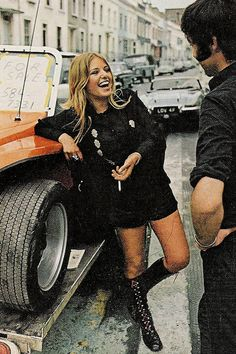 1972.  In love with the black lace up knee high boots.