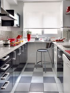 I just love black and white kitchens with red accents!