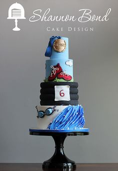 Triathlon Cake for the die hard triathlete! Eat cake to carb load and swim, bike, run your Ironman heart out by Shannon Bond Cake Design www.sbcakedesign.com