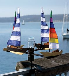 Solar- and Wind- Powered Sailboat Spinner with LED Beacon Light from WindandWeather.  This is right up my alley!