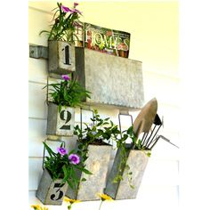 Industrial Farmhouse Hanging Wall Pockets  Galvanized hanging wall pockets.  3 small numbered pockets, 2 medium pockets, 1 large pocket.  Large pocket is wide enough for magazines.  Great for office, porch, bathroom, anyplace that needs a little fun storage.