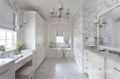 This serene master bath features durable materials and a functional layout. - Photo: Ryann ford  Design: Marie Flanigan