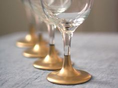 Dip in gold paint for a New Year's or Christmas party. | 24 Clever Things To Do With Wine Glasses