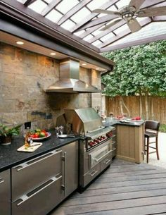 56 Awesome Outdoor Kitchen Designs : 56 Awesome Outdoor Kitchen Designs With Brown Stone Wall Kitchen Island Sink Oven Stove Grill Machine Lamp Chair Table And Fruit And Hardwood Floor And Hook Design With Glass Roof And Fan