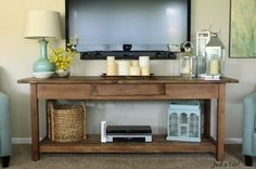 Rustic console table for under wall mounted TV. The DVD & DVR components are hardly noticeable.: