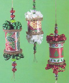 Thread Spool Ornaments (picture only) - from thread spools, curling ribbon & leftover beads; wrapping paper/part old Christmas card where the thread used to be