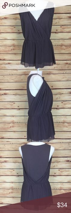 Deletta Tank Top Crepe V Neck Purple Anthropologie Anthropologie Deletta tank top. Purple. Draped crepe detailing. V neck. Slight peplum. Size medium. Body: 60% Pima cotton 40% modal. Trim: 100% polyester. Excellent preowned condition with no flaws. Anthropologie Tops Tank Tops