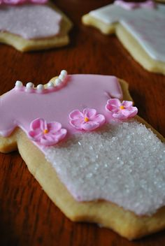 Girl baby shower onesie cookies. Easy sugar cookie cutouts. http://rollingsin.com/2015/01/11/holiday-cutout-cookies/