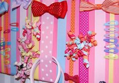 I have 3 hanging ribbons full of Baby Y's bows but they are on the back of her door and move around alot.  I might try making this in a large version.