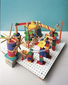 Marble Run:  Many children enjoy tinkering with machines, taking things apart, and learning how stuff works, just for fun.  This Peg-Board Marble Run embraces that curiosity; the clacking gumball machine runs without electricity, all with parts found in the kitchen and toy box.