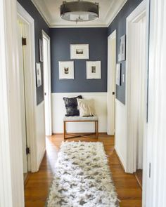 Home sweet Home Love this idea for decorating in a hallway! Navy upper walls white lower and a Love this idea for decorating in a hallway! Navy upper walls white lower and a small bench with pillows and picture frames at the end of the hallway. Small Bench, Design Case, Style At Home, Home Fashion, Home Goods, Sweet Home, New Homes, Room Decor, House Design