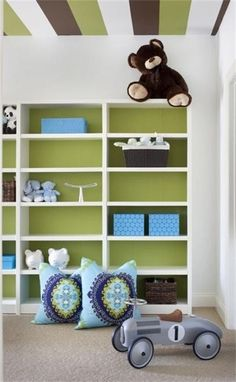 for a little fun, paint stripes on the ceiling to match colors in the room decor