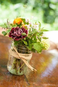 this is the kind of centerpiece I want, but not going to be rustic! :)--Rustic Mason Jar Wedding Centerpiece ///// {Drinkwater Flowers & Design}