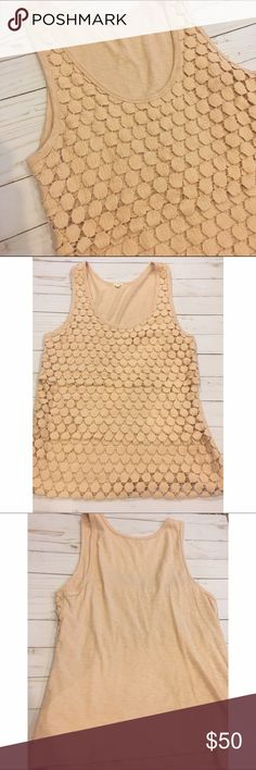 J. Crew Tiered Dot Tank Tiered dot top (see picture 4) that has the dots on the front and is just plain on the back. Really pretty to pair with skinny jeans. Gently worn and in good condition. J. Crew Tops Tank Tops