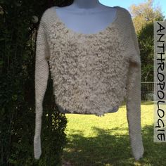 NWOT Anthropologie Ivory White Wool Blend Shrug NWOT Anthropologie Ivory White Wool Blend Shrug Cardigan with eyelet hooks. 81% wool, 10% acrylic. I'm offering 30% off 2 items or more OR 4/$20 on the red dot items. Also, you can use the red dot items to make my discount of 30% off 2 items or more kick in  Anthropologie Sweaters Shrugs & Ponchos