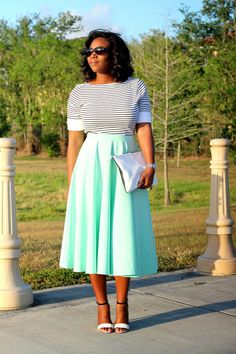 Stripes, mint & the Love,Cortnie 'Two-Faced' leather clutch.   via My Garments of Praise: Not Your Typical Black & White