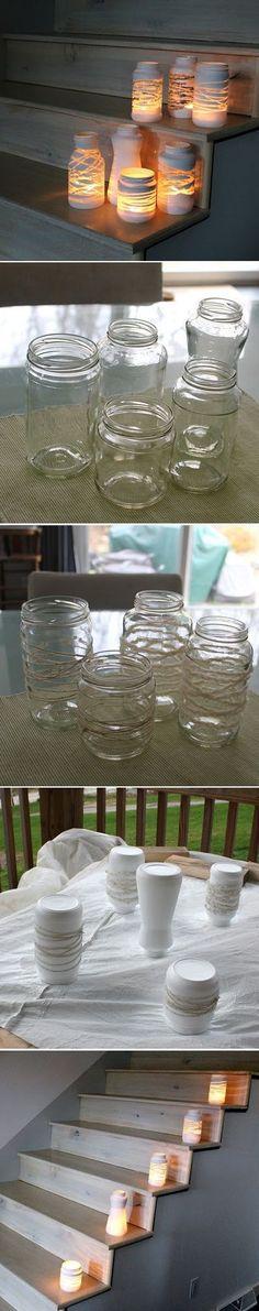 DIY Yarn Wrapped Jam Jars | Recicla los tarros de cristal: con un poco de pintura blanca y unas cuerdas, puedes hacer estas curiosas lámparas-candelabro. #hazlotumismo #doityourself #manualidades