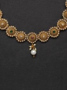 Floral design necklace set with pearl and red, green stones