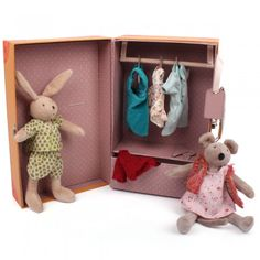 The little wardrobe suitcase Moulin Roty The Little Wardrobe Suitcase, features a rabbit toy and a mouse toy, various clothing items, hangers and a clothing rail presented inside the orange La Petite Armoire style suitcase. Measures 19cm x 29cm x 12.5cm and fastens with a silver snap clasp. Suitable for ages three and ove