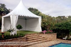 This springtop tent next to a pool in Remuera provided a great space for guests to get some shade. Marquee Hire NZ