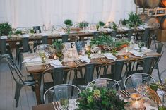 Industrial table and chairs. Industrial garden birthday party 50th. Lush garden meets industrial warehouse vibe. Edyta Szyszlo Photography. Venue: Pier 48 San Francisco, California.