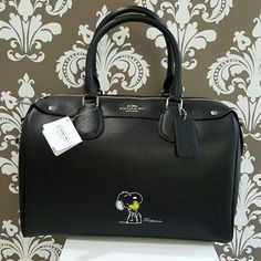 Limited edition Coach Snoopy large Bennett Limited edition Coach Snoopy large Bennett in black.  Includes matching shoulder strap.  Sold out in stores!!! Coach Bags Satchels